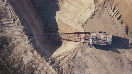 bagger : Flying over the excavator in a quarry. aerial survey in 4K