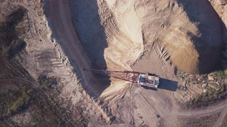 bagger : Flying over the excavator in a quarry. aerial survey 4K