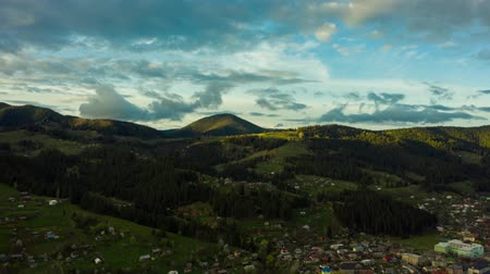 palmo : Timelapse of mountains forest filling frame with clouds in foreground