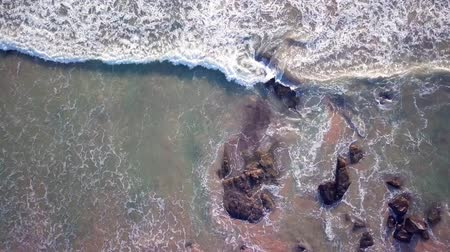 шри : Aerial view of ocean waves and fantastic Rocky coast at Sri Lanka. Danger sea wave crashing on rock coast with spray and foam before storm Стоковые видеозаписи