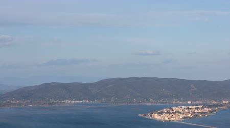 promontory : The city of Orbetello and of the homonymous lagoon seen from the Argentario promontory in Tuscany, Italy. Timelapse.