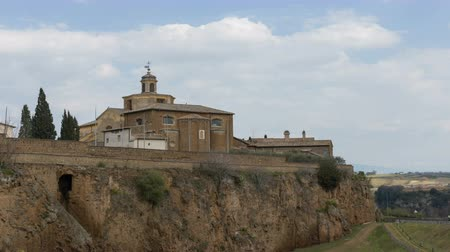 templomtorony : The church of Santa Maria Maggiore in Civita castellana. Timelapse the clouds on the church. Viterbo, Italy. Stock mozgókép