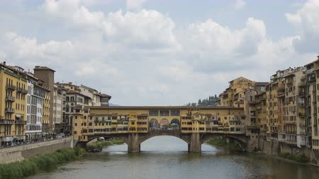 toszkána : Time lapse of the old bridge in Florence. Florence, Ponte Vecchio. Florence view of the old bridge Arno and the clouds. 4k.