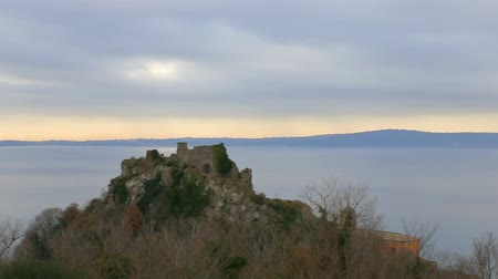 kamenné zdivo : The fortress of Trevignano on Lake Bracciano. Italy. The ruins on the lake. The castle on the lake. Dostupné videozáznamy