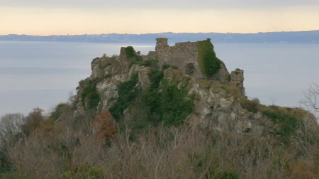 taş işçiliği : The fortress of Trevignano on Lake Bracciano. Italy. The ruins on the lake. The castle on the lake. Stok Video