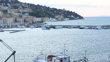 toskánský : March 23, 2018, Porto Santo Stefano, Italy. In the port of the city of Porto Santo Stefano the fishing vessels return after fishing.