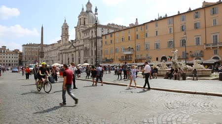 bernini : May 12, 2018, Rome, Italy. Tourists at Piazza Navona in Rome. Video of Piazza Navona in Rome. Church of SantAgnese in Agone at Piazza Navona in Rome.