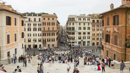 bernini : May 12, 2018, Rome, Italy. Tourists in Rome in the Spanish Steps. Spanish Steps and the Barcaccia fountain in Rome. Crowd of tourists in Piazza di Spagna with the Barcaccia fountain and Via dei Condotti in Rome. Timelapse. 4k.