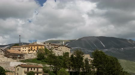 June 3 2018, Castelluccio di Norcia, Italy. Time lapse of clouds at Castelluccio di Norcia. The village of Castelluccio. 4k. Wideo