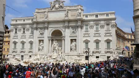 bernini : May 12, 2018, Rome, Italy. Crowd of tourists at Trevi Fountain. Tourists in Rome at Trevi Fountain. Piazza di Trevi in Rome. Stock Footage