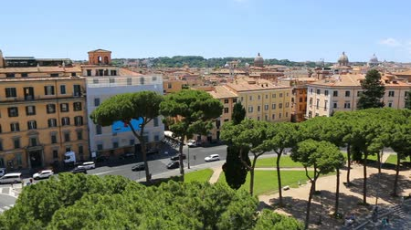 viktoriánus : 09-06-2018 Rome, Italy. Panorama of Rome from the Vittoriano with the roofs of the houses and the domes of some churches. Stock mozgókép