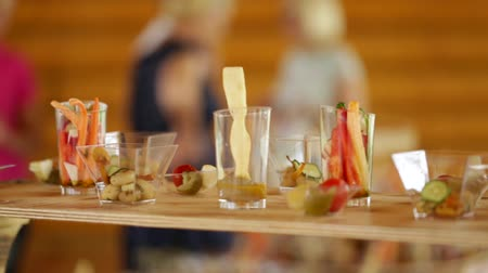 placas : Various snacks on a buffet table at the event, the camera moves smoothly. Guests gather for a party. Vídeos