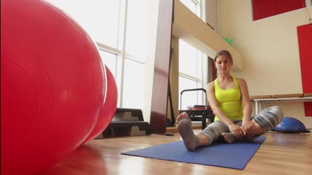 activating : Sport, cute girl performs a set of exercises to stretch the hips