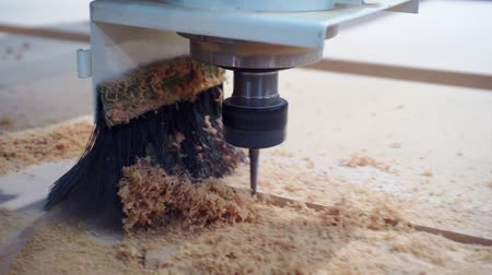drilling wood : modern production process in the enterprise.Woodworking and furniture manufacturing.digital control production machine in action.Special milling surface treatment of furniture panel.Close-up. Stock Footage