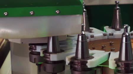 drilling wood : Woodworking and furniture manufacturing.technological process.set of cutters for various purposes is located on the carousel for automatic replacement on a modern woodworking machine.close-up