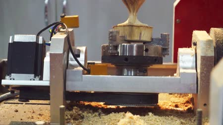 processed : woodworking and furniture production.technological process.Milling a wooden detail.Processing of wooden on CNC coordinate milling woodworking machines.modern CNC woodworking machine.close-up