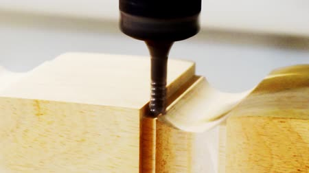 tokarka : Woodworking and furniture manufacturing.technological process.cnc router processes wood detail with cutter.close-up.shallow depth of field.