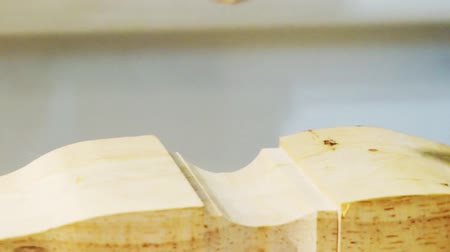 drilling wood : Woodworking and furniture manufacturing.technological process.cnc router processes wood part with cutter.close-up.shallow depth of field.