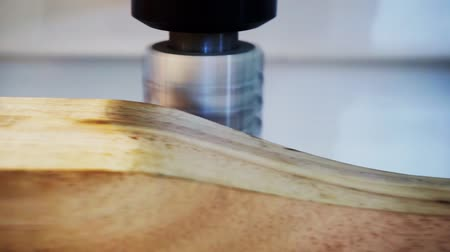 technological process : Woodworking and furniture manufacturing.technological process.cnc router processes wood part with cutter.close-up.shallow depth of field.