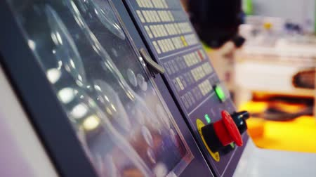 controlador : control panel.Close-up view of a buttons on an industrial control panel of an electric machine Stock Footage