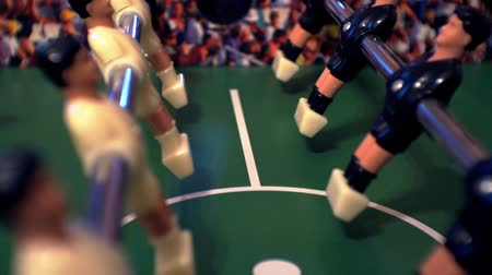 poppetjes : Games, entertainment, hobbies and leisure. Football for the kicker with miniature players. Foosball with plastic figures. Indoor table football - a game in the office. Close-up. Shallow depth of field