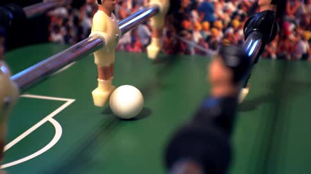 miniatűr : Games, entertainment, hobbies and leisure.foosball.plastic players in the table soccer.game kicker close up.Shallow depth of field