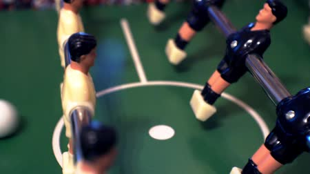 miniatűr : foosball.small plastic figures of players in table soccer.game kicker.close-up.shallow depth of field. Stock mozgókép