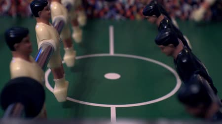 miniatűr : foosball.small plastic players in the table soccer.game kicker close up.Shallow depth of field.