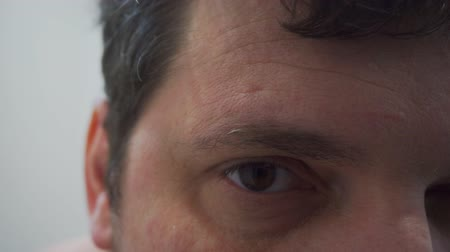 magnifier : look of a curious man who is looking with interest at the camera.Close-up.Shallow depth of field. Stock Footage