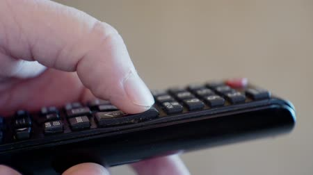 infrared : male hand holds a TV remote control Stock Footage