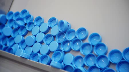 fornada : bottle caps moving along the production line Stock Footage