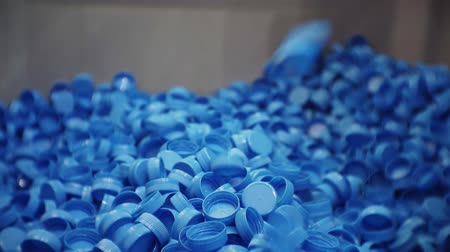 ラッピング : blue plastic corks fall into a large box. 動画素材