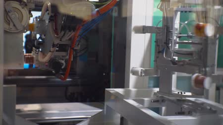 suction cups : automated line produces plastic cups
