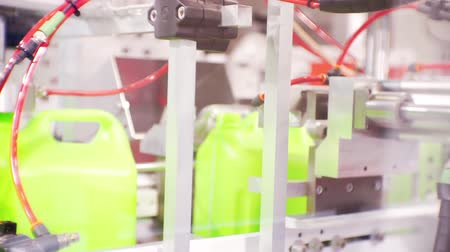 suction cups : Thermoplastic on the automated line produces plastic cans. Close-up.