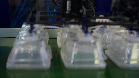 suction cups : line production of plastic disposable containers. Stock Footage