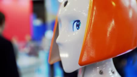 talk show : Head of a cute robot woman similar to a man close-up.