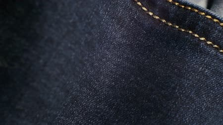 coudre : vieux jeans usés closeup.moving background pour votre conception