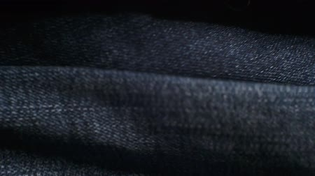 шов : old worn jeans cloth closeup.moving background for your design