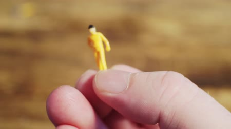 figurka : small toy man in the hands of a man.close-up. Dostupné videozáznamy