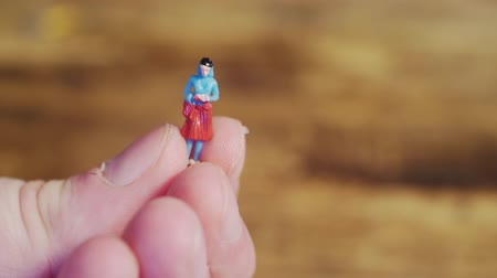 macro shooting : small toy man in the hands of a man.close-up. Stock Footage