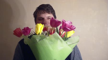 cheerful smiling man with a bouquet of flowers Stock Footage