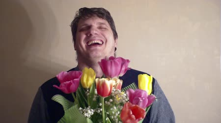 урод : Portrait of a funny cheerful man with a bouquet of flowers