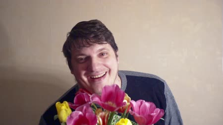 funny smiling man with a bouquet of flowers