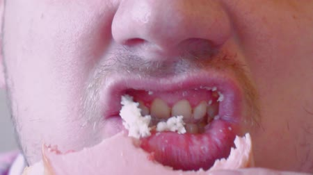 hungry man chews food.face close-up