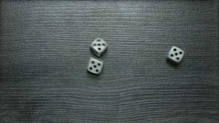 Poker Dice rolling three of a kind on five
