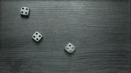 Poker Dice rolling three of a kind on four