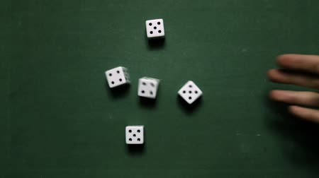 Poker Dice rolling full-house five and four