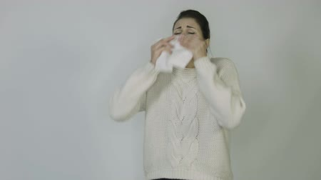 influenza background : girl with a temperature in the jacket sneezes