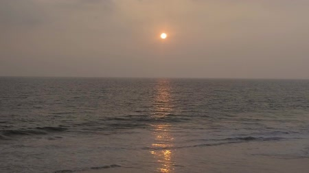 hikkaduwa : Tropical sunset. The sun sets over the beach ocean, the sea waves in the evening light Stock Footage