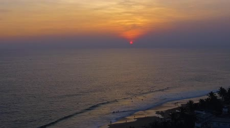 hikkaduwa : Tropical sunset. The sun sets over the ocean in tropical country, the sea waves in the evening light